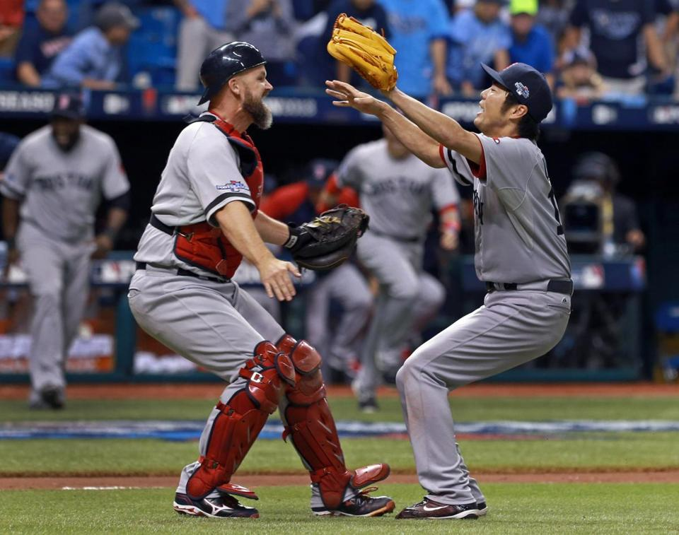 David Ross, left, and Koji Uehara celebrated after recording the final out of the Game 4 win that eliminated the Rays.