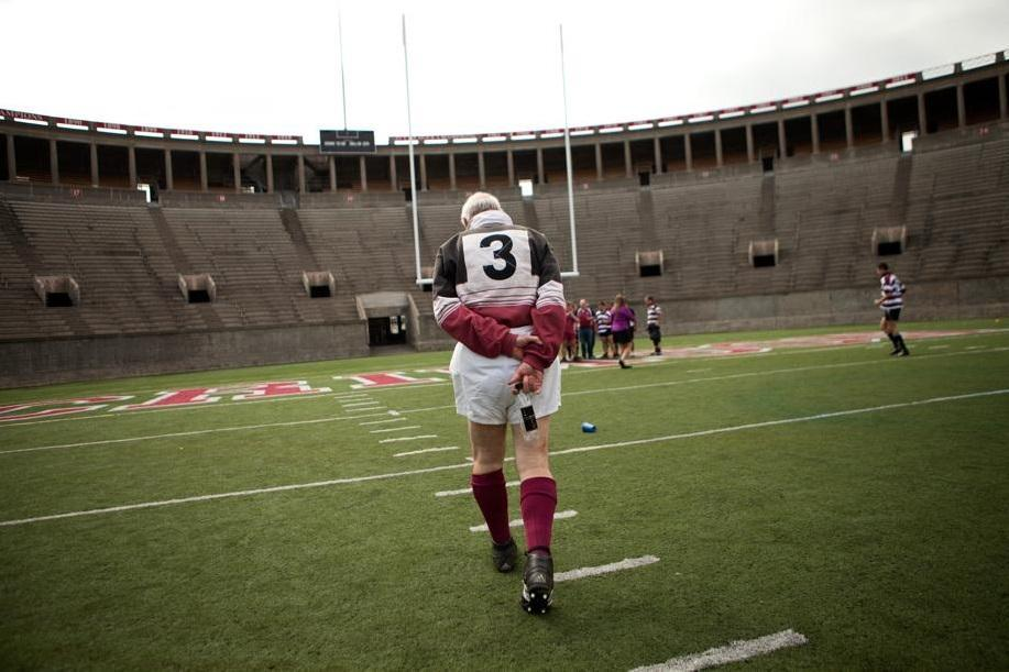 Gene Skowronski, 69, walked the Harvard Stadium field after taking part in some reunion rugby matches Saturday.