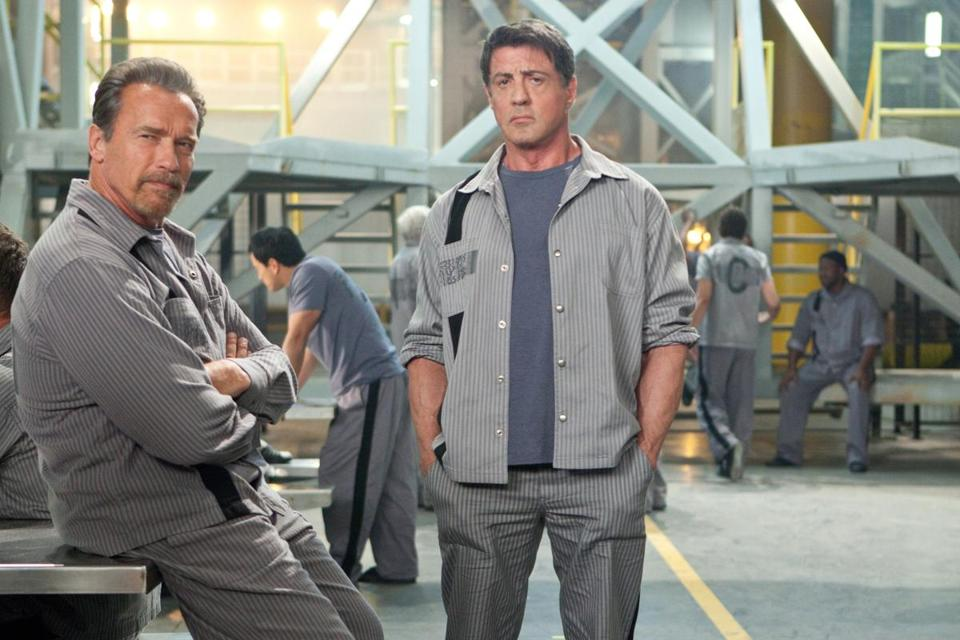 "Arnold Schwarzenegger (left) and Sylvester Stallone star in the action flick ""Escape Plan."""