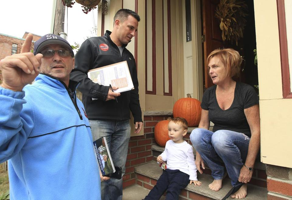 Jim McKay (left) and Peter Barbuto spoke with Dolly Pickup and her grandson, Jackson, in South Boston on Saturday as they worked to build support for Martin Walsh's mayoral bid.