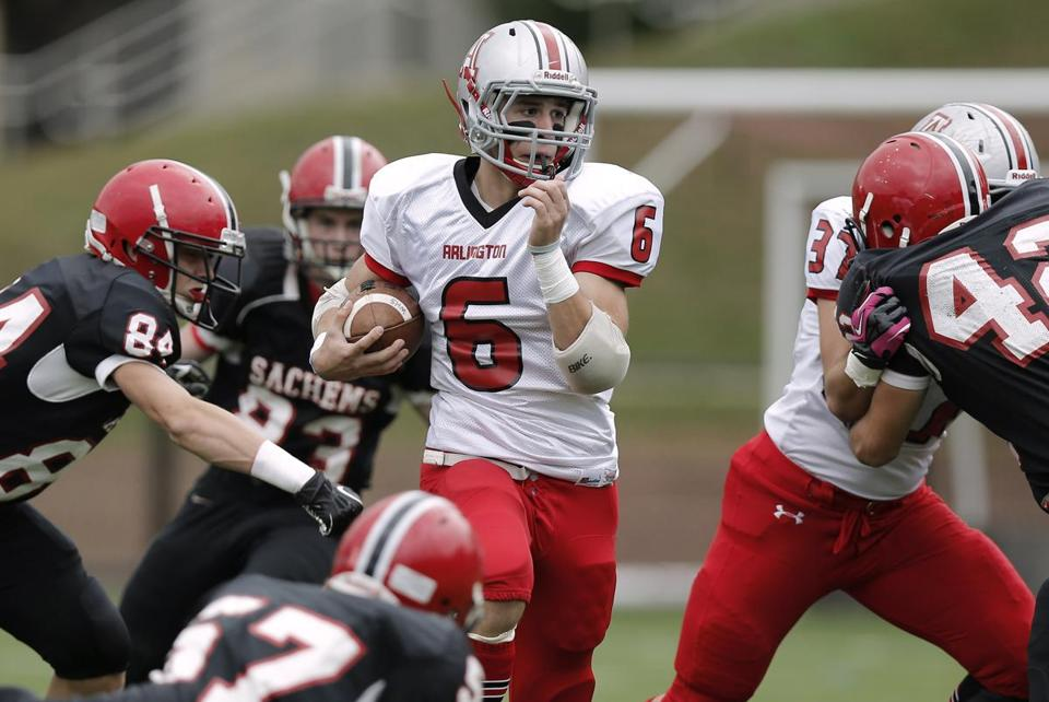 Arlington's Frank Roche, who ran for two touchdowns, slips through the Winchester defense with help from his blockers.