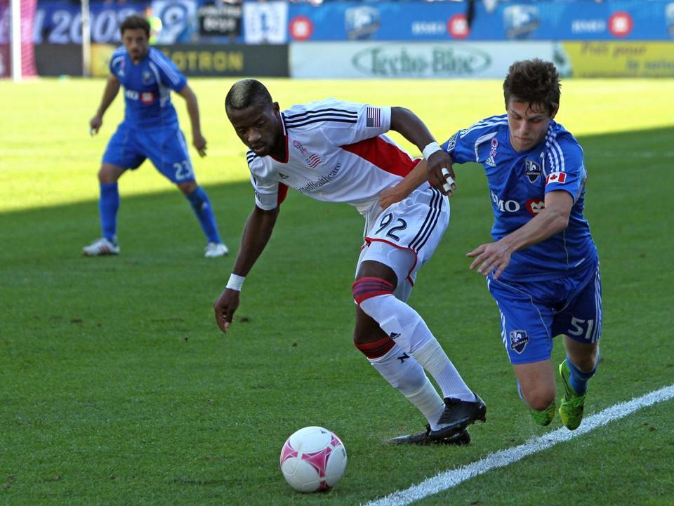 Revolution forward Dimitry Imbongo (left) and Impact defender Maxim Tissot battled for the ball during the first half.
