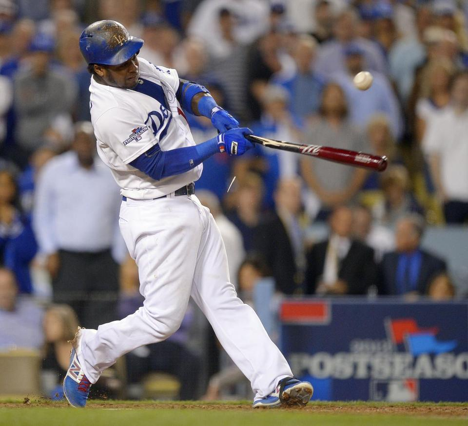 Hanley Ramirez breaks his bat while delivering an RBI single in the eighth inning.