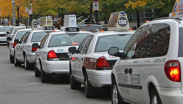 Taxi cabs were parked on Atlantic Avenue by the South Station bus terminal.