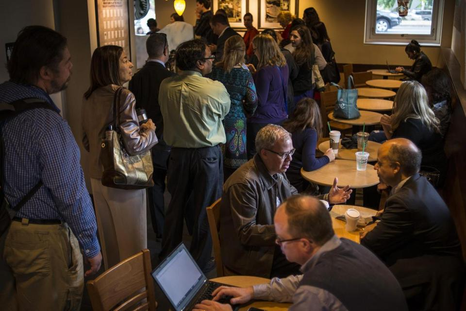 Furloughed federal workers will get back pay, which may let retailers see stepped-up spending soon. Above, the scene in a Washington Starbucks after the shutdown ended.