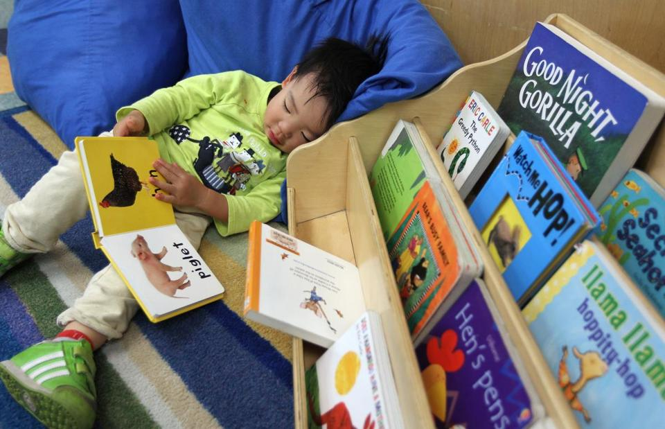 Joon Lim, 2, relaxes with a book at a day-care center run by Bright Horizons, which has been a number one employer three times.