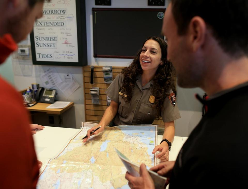"Acadia National Park ranger Tara Harbert worked at visitors center on Thursday. ""We love being back to work,"" she said."