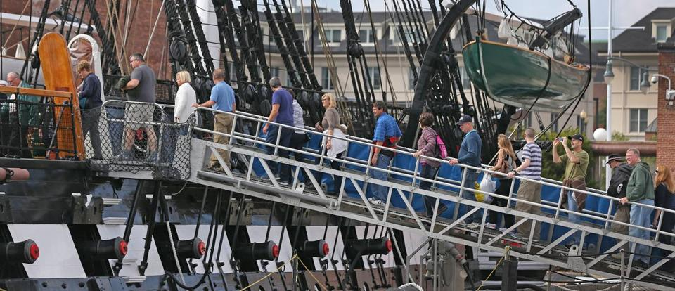 Visitors lined the  gangway to take a tour of the USS Constitution at the Charlestown Navy Yard on Thursday, as National Park Service sites reopened.