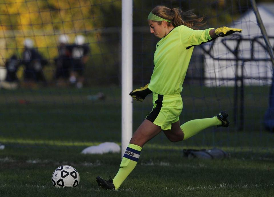Peabody High goalkeeper Caitlin Lodi defends against Revere during their soccer game.
