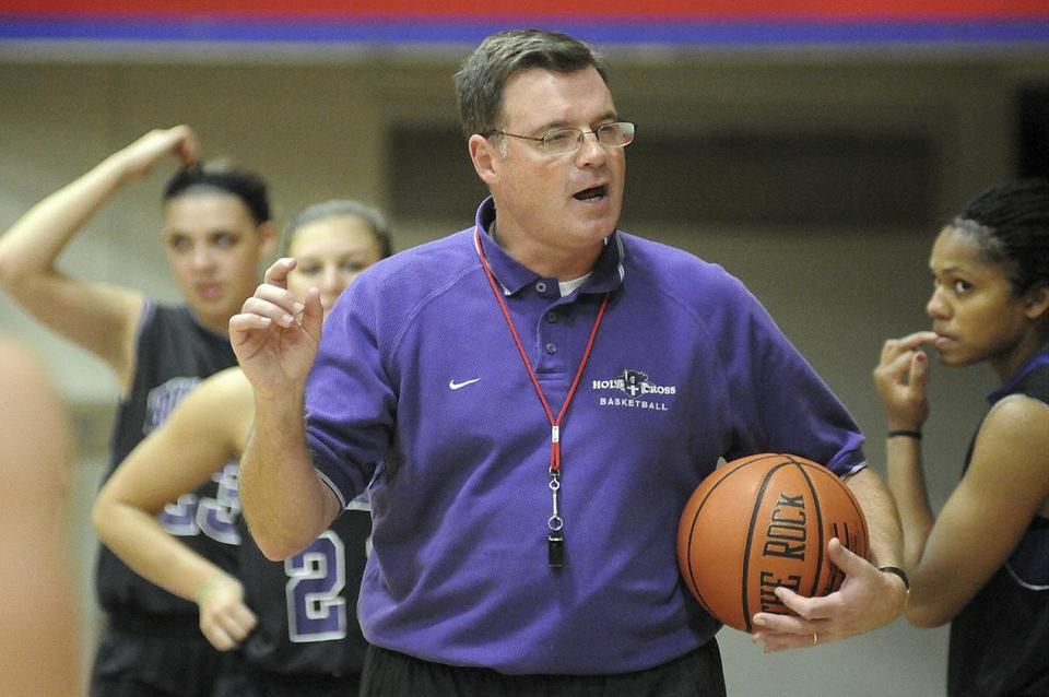 "In this Nov. 4, 2010 photo, Holy Cross women's basketball coach Bill Gibbons outlines a play for his team during practice at the Hart Center in Worcester, Mass. Former Holy Cross player Ashley Cooper, 20, filed a lawsuit in New York Tuesday, Oct. 15, 2013, against the school, Gibbons, and school officials claiming Gibbons was ""verbally, emotionally and physically abusive."" (AP Photo/The Telegram & Gazette, Steve Lanava)"