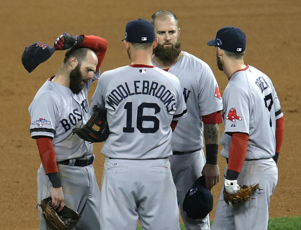 Red Sox infielders gathered during a pitching change in the fourth inning of Game 4.