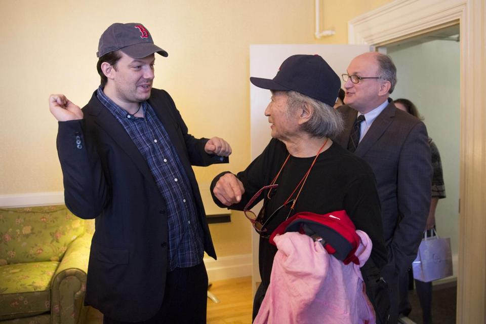 Andris Nelsons (left) and Seiji Ozawa (center) in their Red Sox hats.