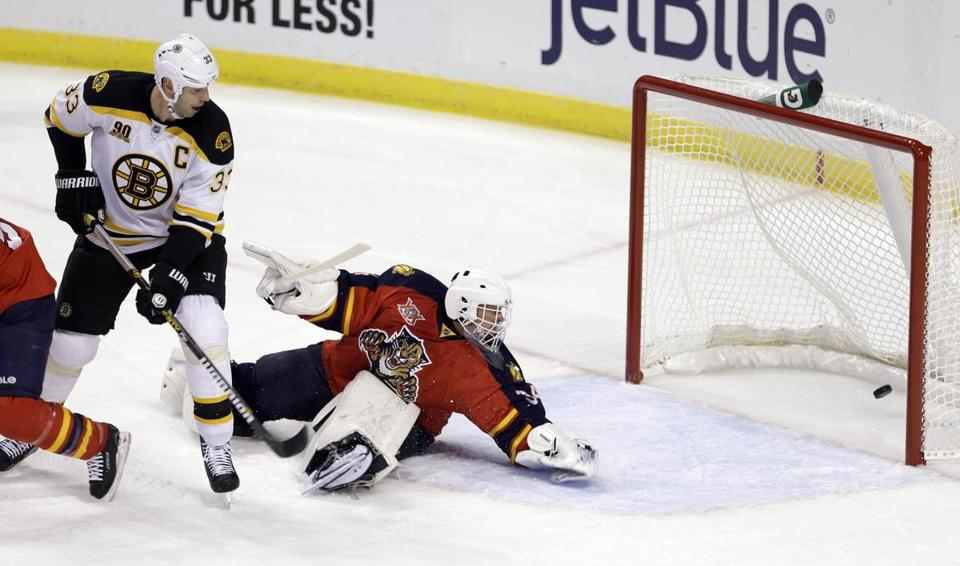 Tim Thomas was unable to stop a shot by Dougie Hamilton in the first period.