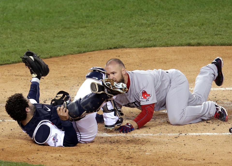 Red Sox catcher David Ross (right) delivered a thunderous hit on Tigers catcher Alex Avila in the four-run second inning. Ross, who has suffered two concussions this year, was out on the play.