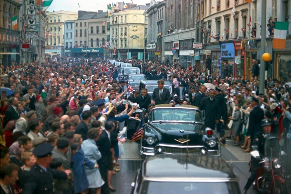 Crowds cheered on President Kennedy during his visit to Cork, Ireland, in 1963. Rose petals were tossed in his path.