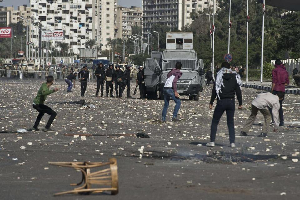 Egyptian students threw stones at riot police near Al-Azhar University in Cairo on Sunday during an antimilitary protest.