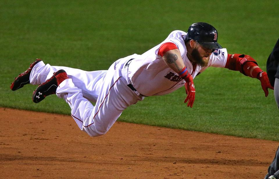 Jonny Gomes dove into second base in the seventh inning.