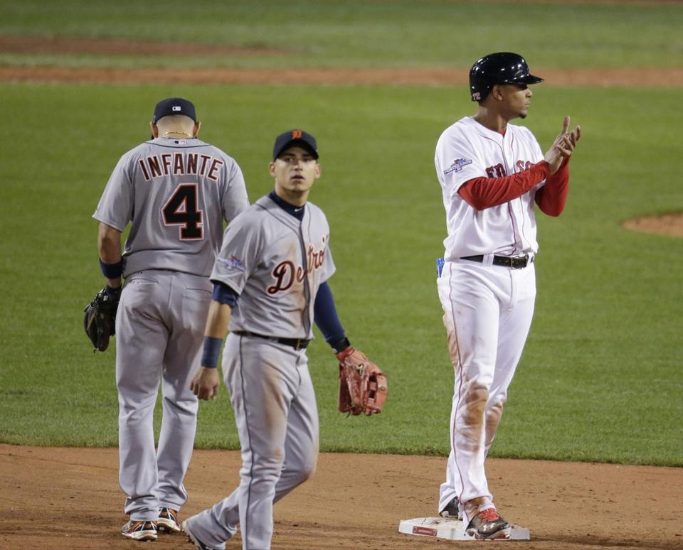 Xander Bogaerts stands safely on second base after Jose Iglesias made a fielding error in the seventh inning during Game 6 of the 2013 ALCS.