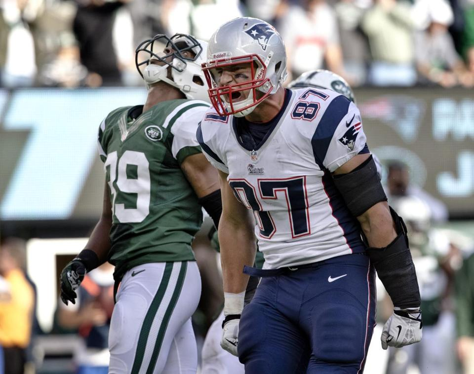 Rob Gronkowski (right) caught eight passes, but Jets safety Antonio Allen (left) had some big moments as well.