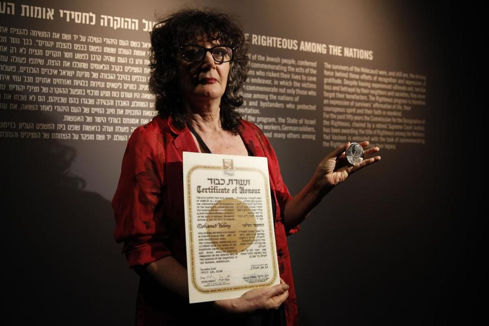 Irena Steinfeldt displayed a medal and certificate honoring Mohamed Helmy at Israel's Yad Vashem Holocaust memorial.