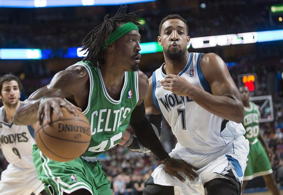 The Celtics' Gerald Wallace drives past Minnesota's Derrick Williams during their preseason game in Montreal.