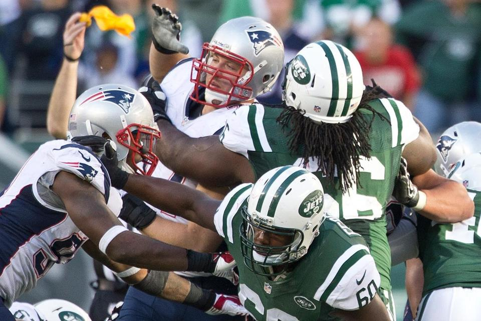 The Patriots' Chris Jones (center) was flagged for a penalty that is new to this season and hadn't yet been called in a game.