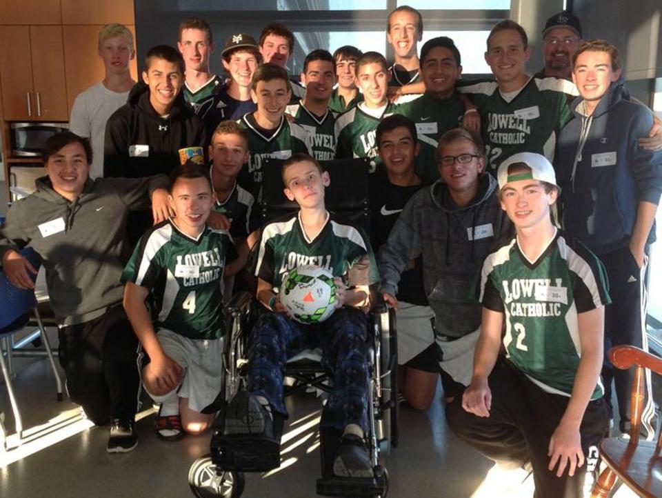 Stephen Janeczko, who suffered a stroke Sept. 20, was visited by his teammates a week later at Spaulding Rehab.
