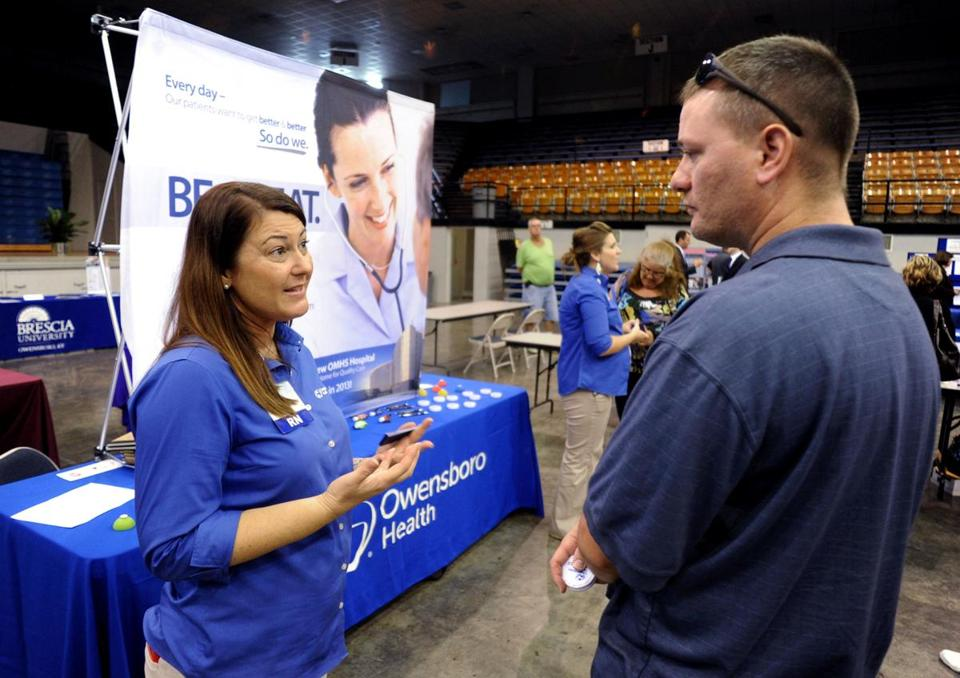 The economy added just 148,000 jobs in September, suggesting employers held back on hiring before a partial government shutdown began. Above, a Kentucky job fair.