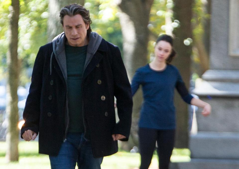 "John Travolta filming ""The Forger"" with Abigail Spencer Monday near the Commonwealth Avenue Mall."