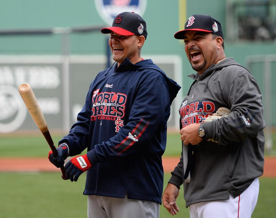 Cardinals catcher Yadier Molina, left, shared a laugh with Red Sox assistant hitting coach Victor Rodriguez on Tuesday.