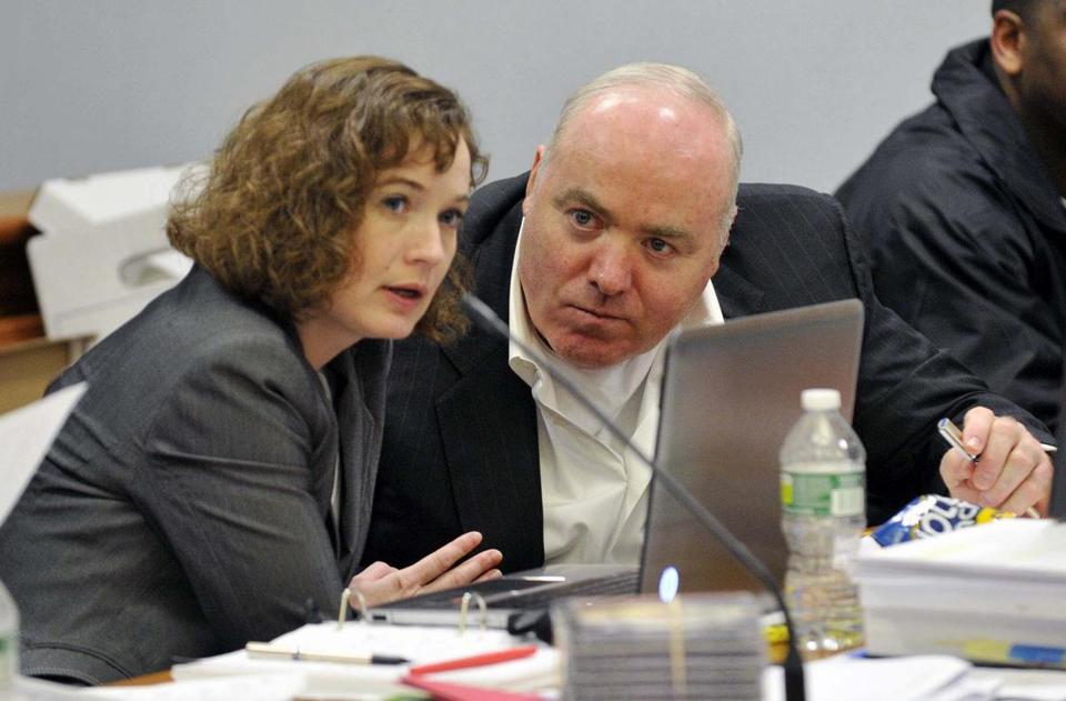 Michael Skakel's conviction in the 1975 slaying of  Martha Moxley was set aside and a new trial ordered by a Connecticut judge. Skakel is pictured with his lawyer, Jessica Santos.