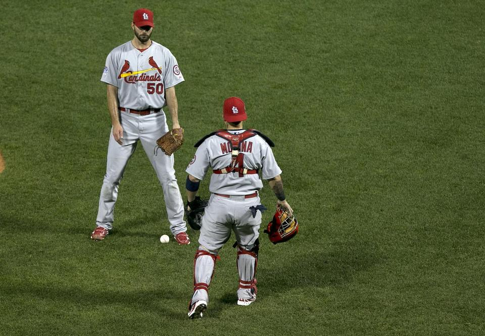 Adam Wainwright and Yadier Molina let a second-inning popup fall in.