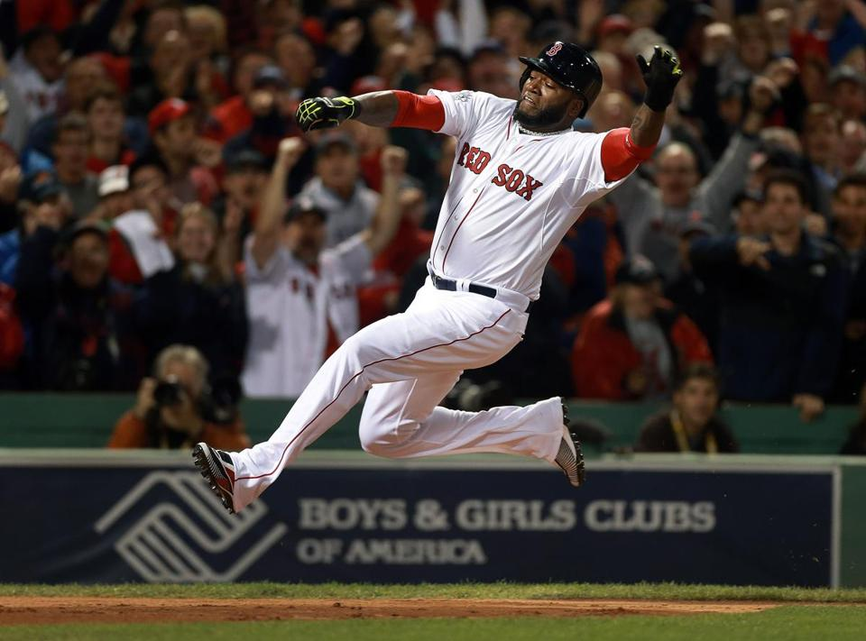 10/23/13: Boston, MA: The Red Sox David Ortiz gets some serious air time as he slides across the plate with the third run on a first inning three run double by teammate Mike Napoli (not pictured). The Boston Red Sox hosted the St. Louis Cardinals in Game One of the World Series at Fenway Park. (Jim Davis/Globe Staff) section: sports topic: Red Sox(1)