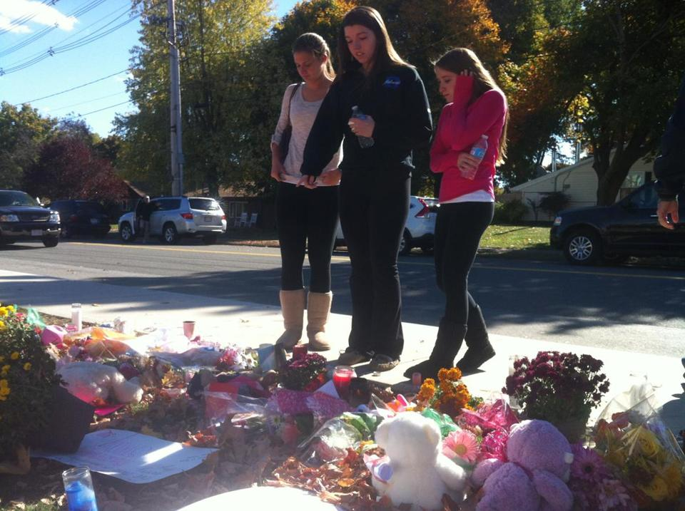 Students paused to pay their respects at memorial for Colleen Ritzer at Danvers High School early Friday.