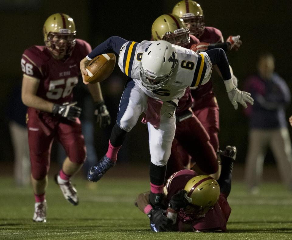 Xaverian's Jake Farrell attempts to wriggle out of a tackle.