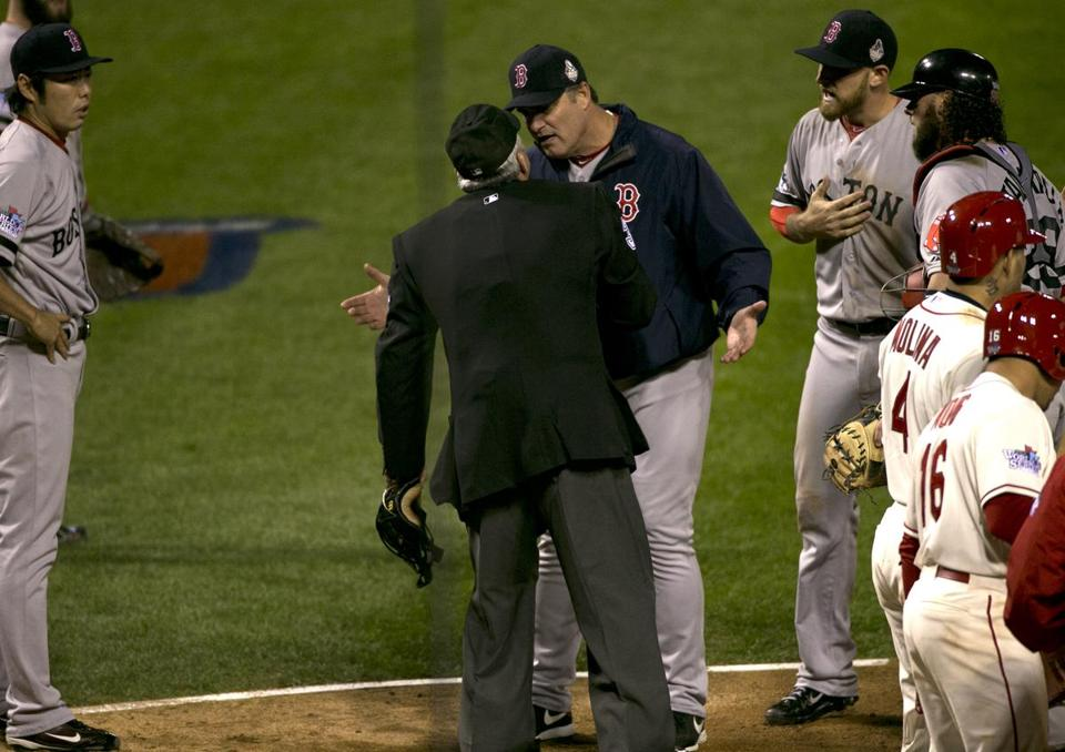Red Sox manager John Farrell argued the call as the Red Sox walked off the field in shock.