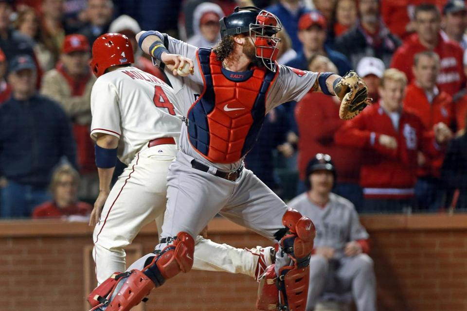 After tagging out Yadier Molina at the plate with the second out of the ninth, Red Sox catcher Jarrod Saltalamacchia came up firing, but his throw to third was low and got past the bag.