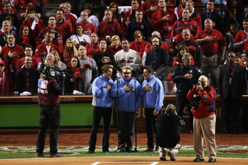 Rascal Flatts performs the national anthem prior to Game Four of the World Series Sunday night in St. Louis.