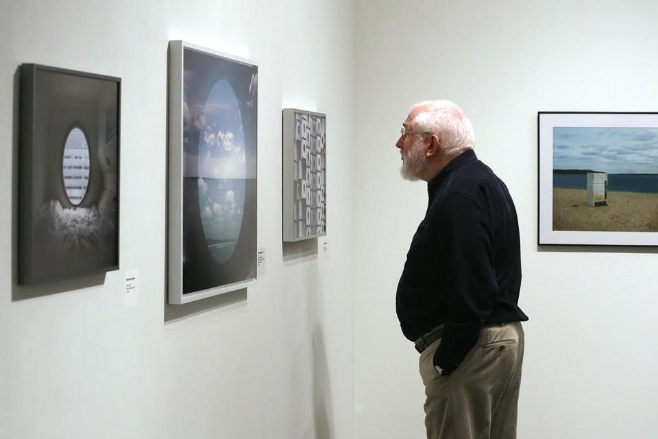 Timothy Wilson, a Somerville photographer, looked at an exhibit at Danforth Art.
