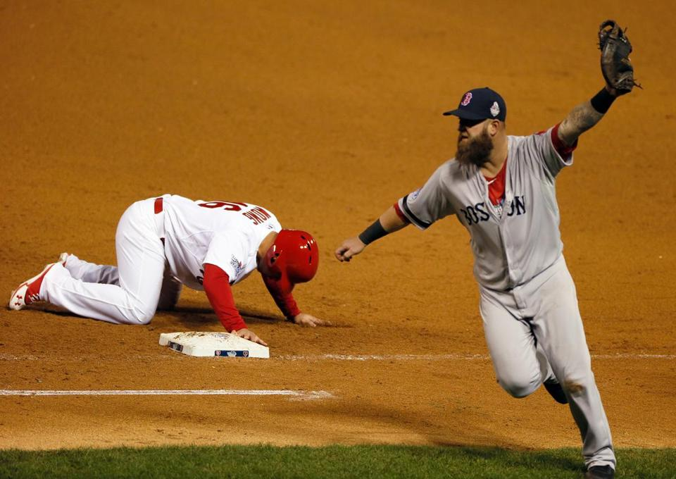 Mike Napoli celebrated after tagging out Kolten Wong on a pickoff throw for the final out.