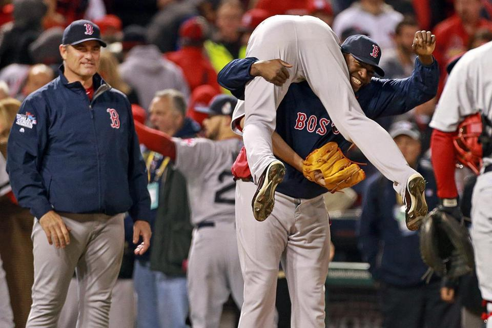 David Ortiz, the man who has carried the Red Sox' offense, carries closer Koji Uehara following their Game 4 victory.