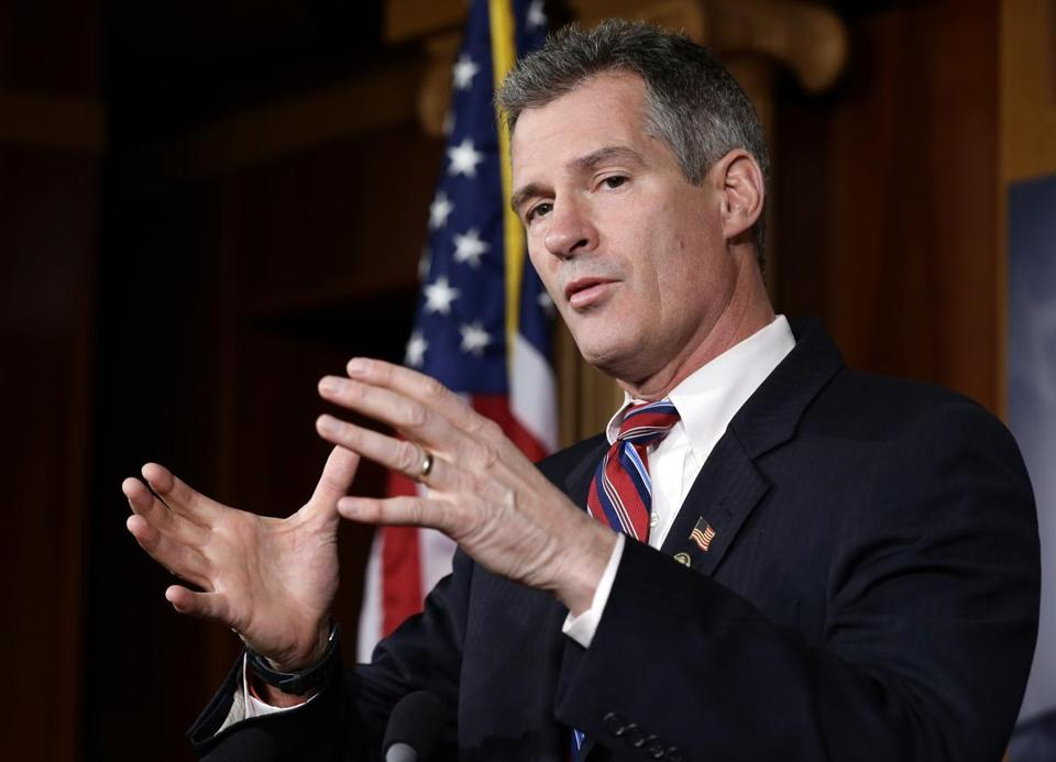 Scott Brown was greeted by more than a hundred protesters during a state GOP holiday party in New Hampshire.