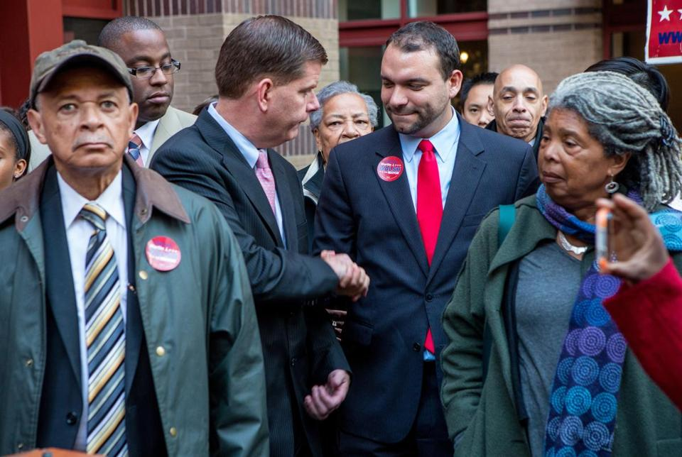 Mayoral candidates Martin Walsh and Felix Arroyo shook hands on Oct. 30, before the election.