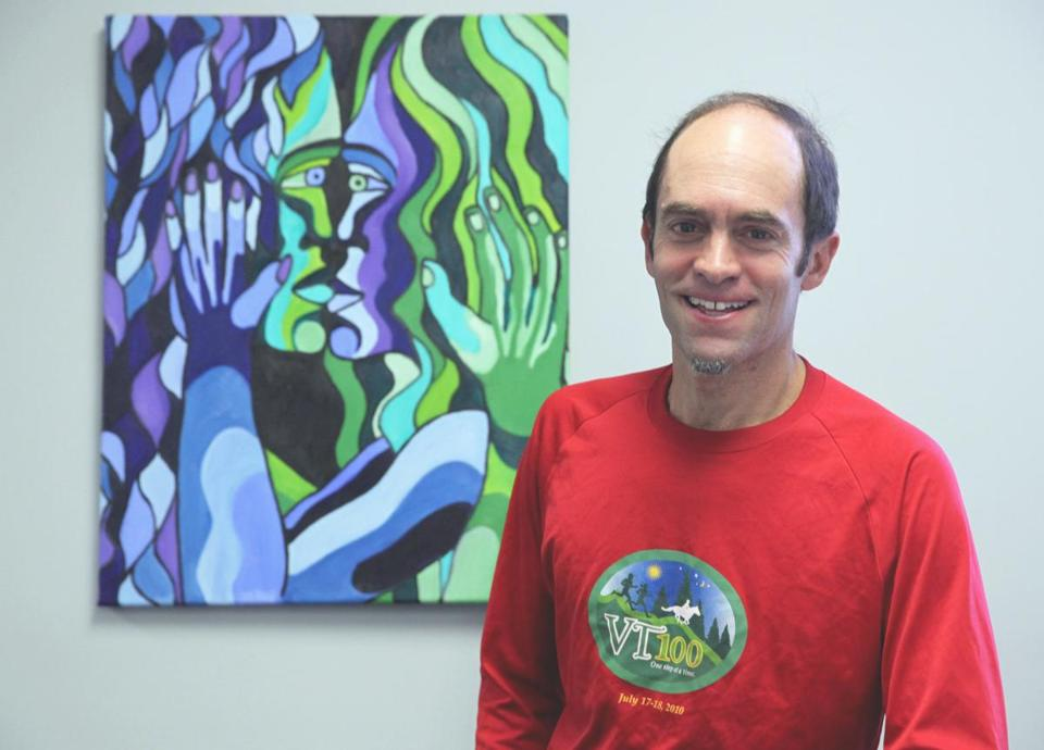 "Artist Andrew Novis with his work ""Blue and Green Lovers Kissing,"" which will be among the works featured during the annual Watertown Open Studios show on Nov. 16 and 17."