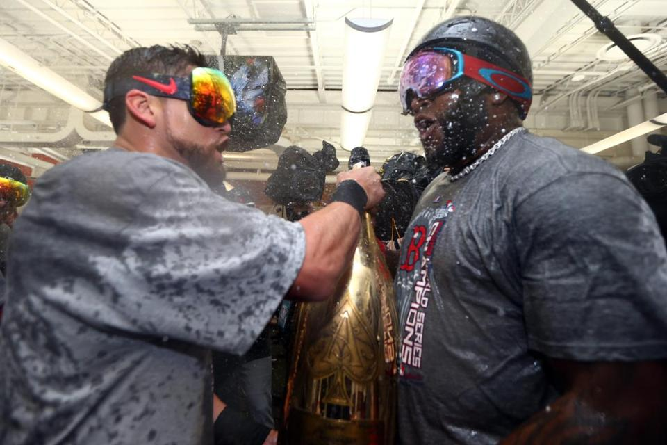 Jacoby Ellsbury (left) and David Ortiz share a $100,000 bottle of Armand de Brignac Nebuchadnezzar Champagne.