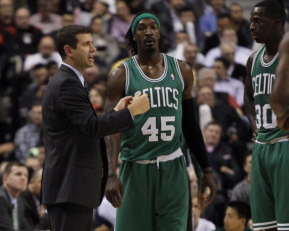 Celtics head coach Brad Stevens spoke to Gerald Wallace and Brandon Bass during a break. The game was Stevens's first as an NBA coach.