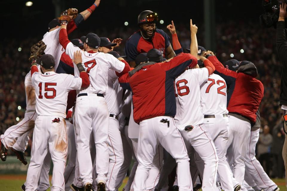 Red Sox designated hitter David Ortiz jumped up into a pile of teammates.