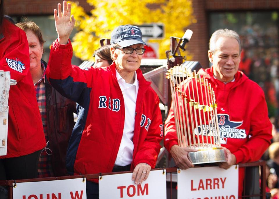 John Henry, center, and the Red Sox are heading into roster-building mode for 2014 now with the World Series celebration behind them.