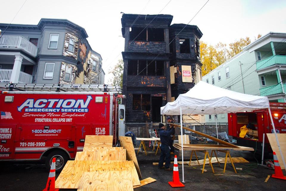 Three firefighters suffered minor injuries battling the blaze in a Dorchester three-decker.