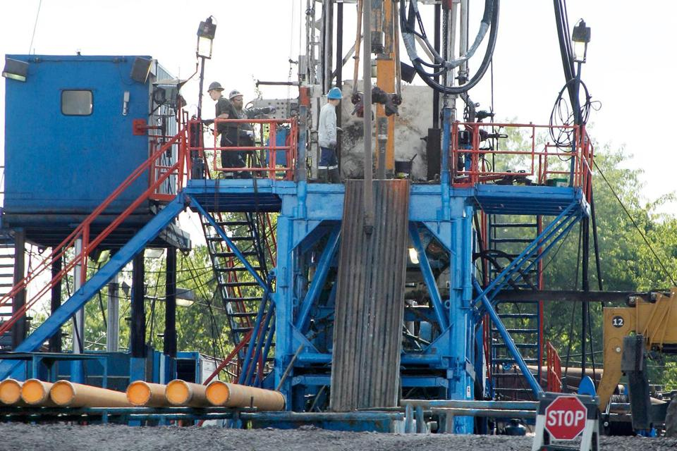 A crew worked on a drilling rig at a well site for shale-based natural gas in Zelienople, Pa.